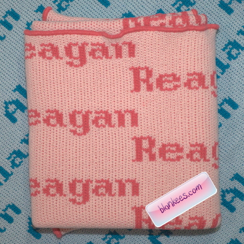 Baby pink personalized baby blanket knit with the name Reagan repeated all over the baby blanket.