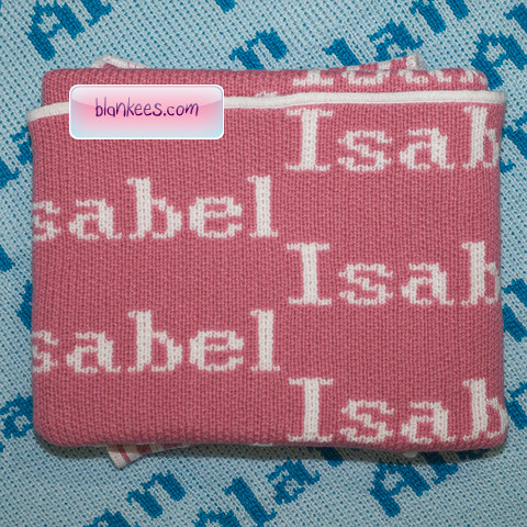 Baby blanket knit with the name, Isabel. Dusty pink baby blanket with white letter and trim.