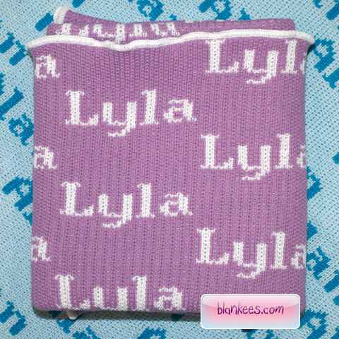 Personalized baby blanket with the baby name, Lyla, knit in white.