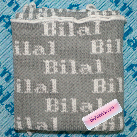 Personalized baby blanket with the name, Bilal, all over the baby blanket.
