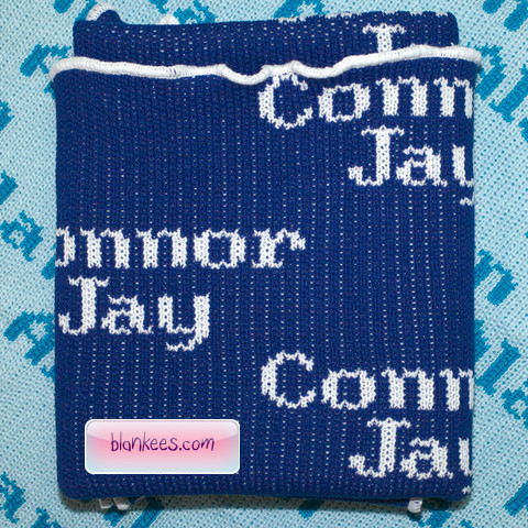Personalized blanket with the name, Connor Jay, repeated all over the blanket.