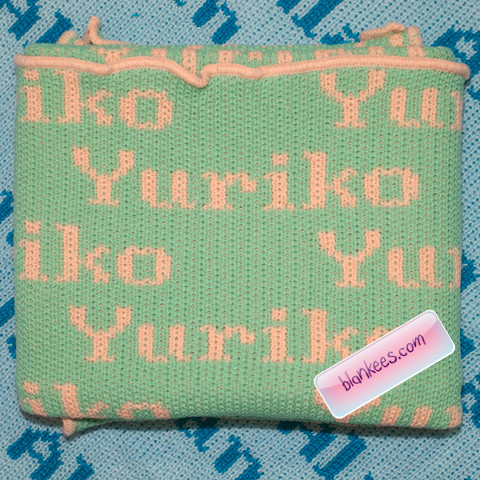Personalized baby blanket with the name, Yuriko, all over the blanket.