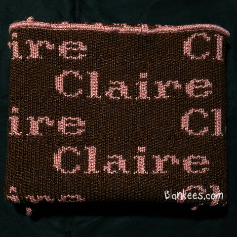 Personalized baby blanket knit with chocolate brown and dusty pink for the name.