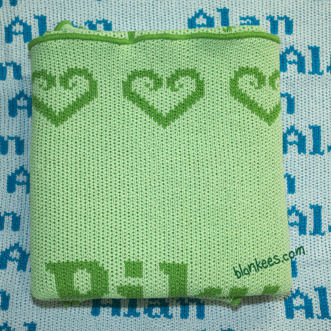 Personalized baby blanket knit with mint green and lime green for the personalization.